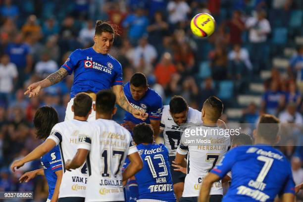 Enzo Roco of Cruz Azul scores the first goal of his team during the 12th round match between Cruz Azul and Pumas UNAM as part of the Torneo Clausura...