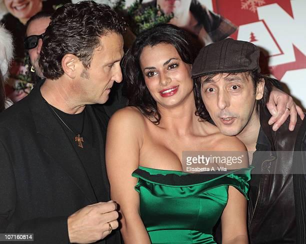 Enzo Salvi Cristina Del Basso and Massimo Ceccherini attends A Natale Mi Sposo premiere at the Adriano Cinema on November 26 2010 in Rome Italy
