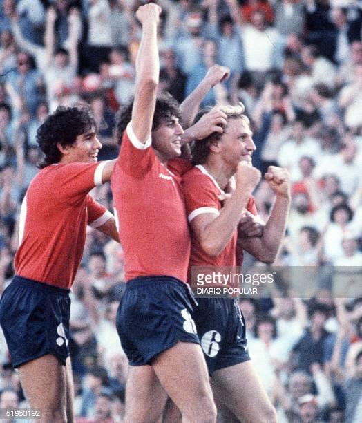 Enzo Trossero of argentinian team Independiente is congratuled by teammates Ricardo Giusti Jorge Burruchaga after scoring 22 december 1983
