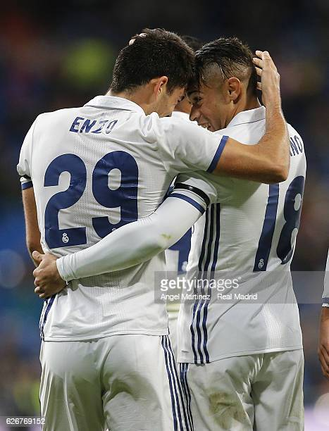 Enzo Zidane of Real Madrid celebrates with Mariano Diaz after scoring their team's fourth goal during the Copa del Rey round of 32 second leg match...
