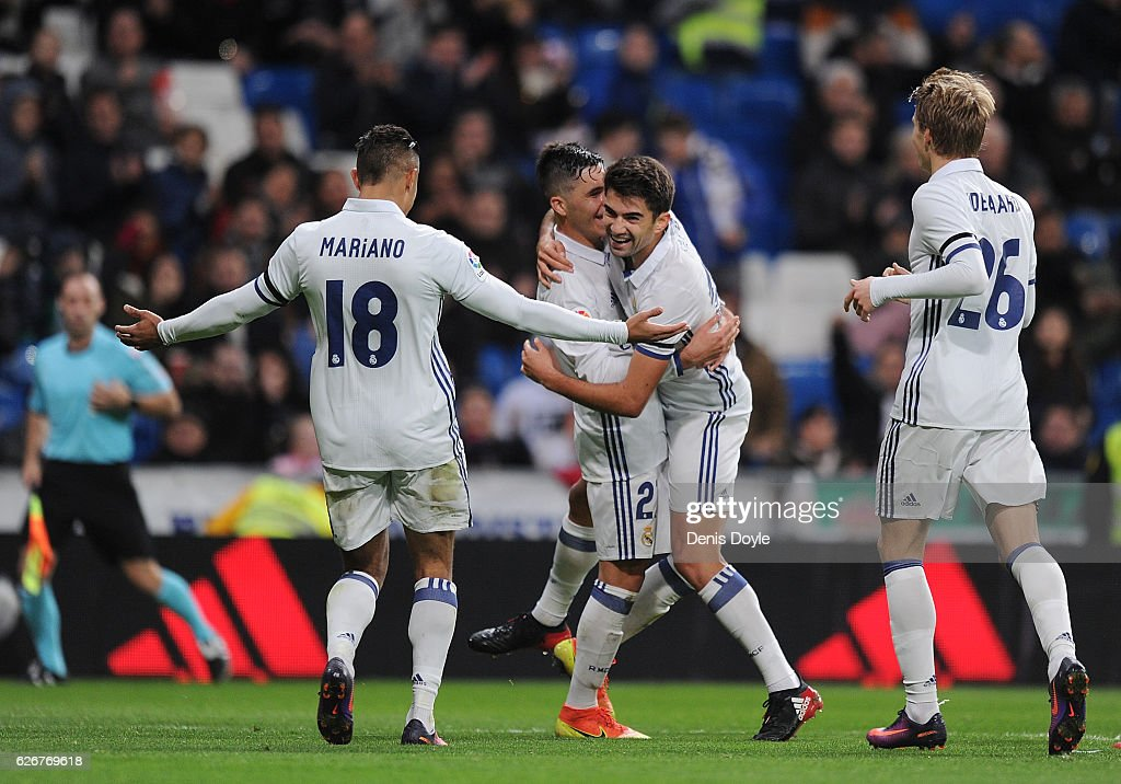 Enzo Zidane of Real Madrid CF celebrates with Alvaro Tejero and Mariano Diaz Mejia after scoring Real's 4th goal during the Copa del Rey last of 32 match between Real Madrid and Cultural Leonesa at estadio Santiago Bernabeu on November 30, 2016 in Madrid, Spain.