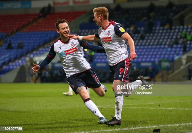 Eoin Doyle of Bolton Wanderers celebrates with Gethin Jones after scoring the opening goal during the Sky Bet League Two match between Bolton...