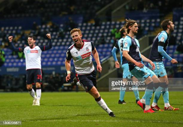 Eoin Doyle of Bolton Wanderers scores the opening goal during the Sky Bet League Two match between Bolton Wanderers and Cambridge United at...