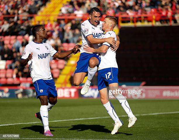 Eoin Doyle of Chesterfield celebrates with team mates after scoring his team's first goal of the game during the Sky Bet League One match between...