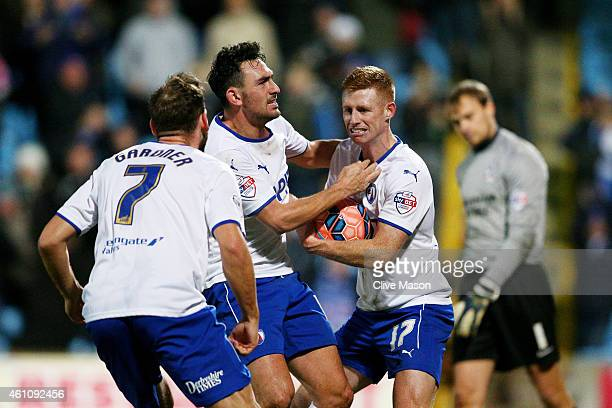 Eoin Doyle of Chesterfield is congratulated by teammates after scoring a goal from the penalty spot during the FA Cup Third Round match between...