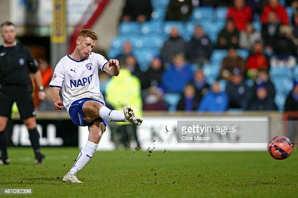 Eoin Doyle of Chesterfield scores a goal from the penalty spot during the FA Cup Third Round match between Scunthorpe United and Chesterfield FC at...