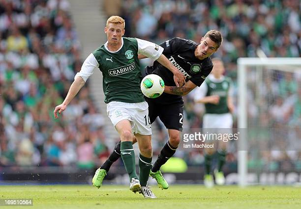 Eoin Doyle of Hibernian competes with Mikael Lustig of Celtic during the William Hill Scottish Cup Final match between Celtic and Hibernian at...