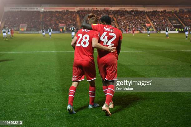 Eoin Doyle of Swindon Town celebrates with Anthony Grant of Swindon Town after scoring his side's second goal during the Sky Bet League Two match...