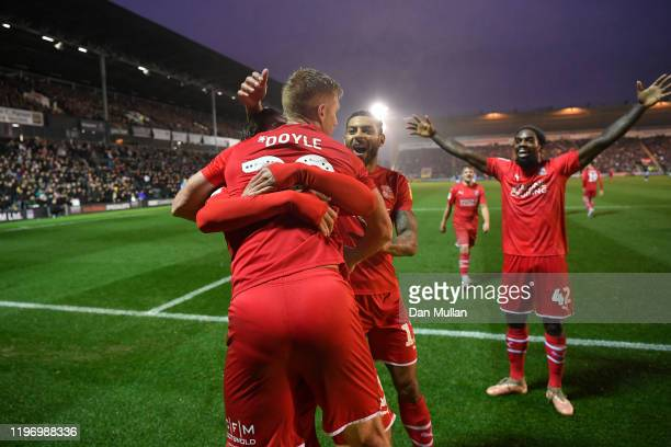 Eoin Doyle of Swindon Town celebrates with his team mates after scoring his side's second goal during the Sky Bet League Two match between Plymouth...