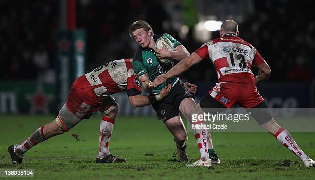 Eoin Griffin of Connacht Rugby cuts between Brett Deacon and Mike Tindall of Gloucester during the Heineken Cup Pool Six match between Gloucester and...