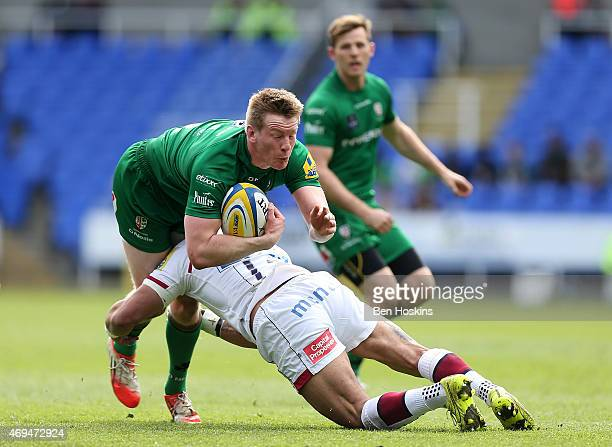 Eoin Griffin of London Irish is tackled by Sam Tuitupou of Sale during the Aviva Premiership match between London Irish and Sale Sharks at Madejski...