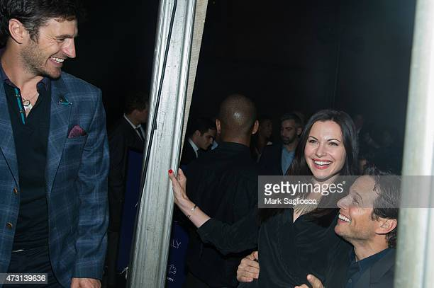 Eoin Macken Jill Flint and Scott Wolf attend the New York Upfronts Party Hosted by People and Entertainment Weekly at The Highline Hotel on May 11...