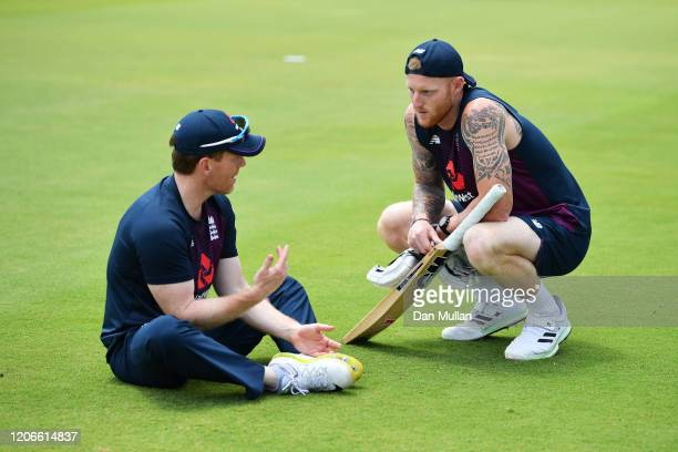 Eoin Morgan and Ben Stokes talk during their warmup ahead of the Third T20 International match between South Africa and England at Supersport Park on...