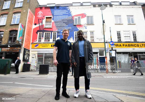 Eoin Morgan and Caleb Femi pose for a photograph in front of an 2019 Cricket World Cup mural on Brick Lane after a 2019 Cricket World Cup countdown...