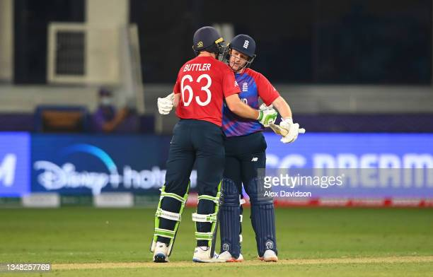 Eoin Morgan and Jos Buttler of England celebrate following the ICC Men's T20 World Cup match between England and Windies at Dubai International...