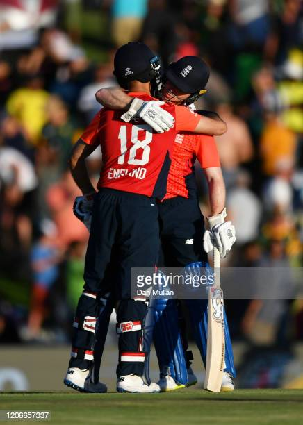 Eoin Morgan and Moeen Ali of England celebrate victory during the Third T20 International match between South Africa and England at Supersport Park...