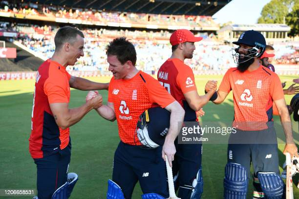 Eoin Morgan and Moeen Ali of England celebrate with Tom Curran and Dawid Malan of England during the Third T20 International match between South...