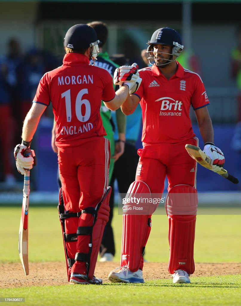 Eoin Morgan and Ravi Bopara of England celebrate the winning runs during the RSA Challenge One Day International match between Ireland and England on September 3, 2013 in Malahide, Ireland.