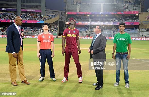 Eoin Morgan Captain of England and Darren Sammy Captain of the West Indies along with match referee David Boon during the toss before the start of...