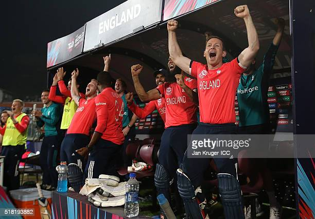 Eoin Morgan Captain of England and his team celebrate the winning runs during the ICC World Twenty20 India 2016 SemiFinal match between England and...
