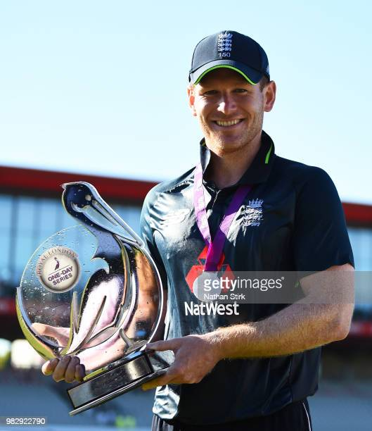 Eoin Morgan holds the Royal One Dap Cup after the 5th Royal London ODI match between England and Australia at Emirates Old Trafford on June 24 2018...
