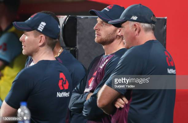Eoin Morgan, Jos Buttler and Chris Silverwood, Head Coach of England look on during the 3rd One Day International match between India and England at...