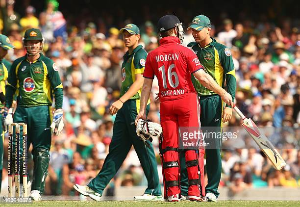 Eoin Morgan of England and Australian captain Michael Clarke have words after Morgan stood his ground to dispute a catch by Daniel Christian of...