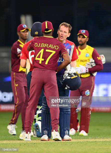 Eoin Morgan of England and Dwayne bravo of West Indies embrace following the ICC Men's T20 World Cup match between England and Windies at Dubai...