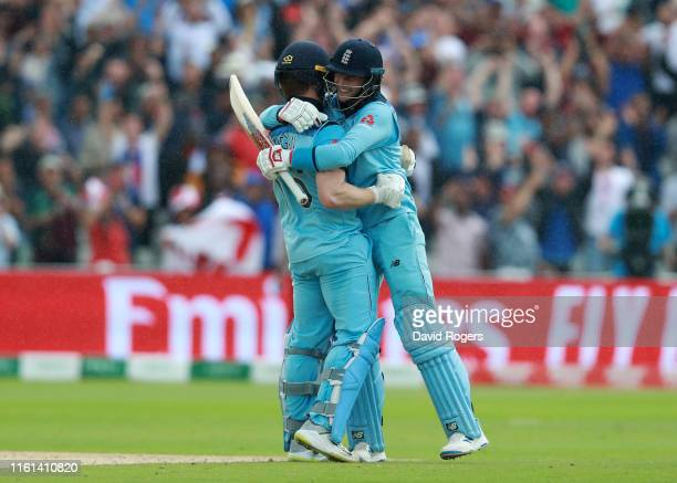 Eoin Morgan of England and Joe Root of England embrace after scoring the winning runs to secure victory and send England to the final during the...
