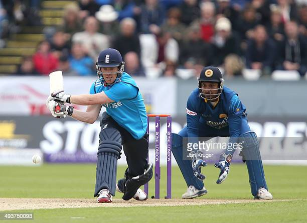 Eoin Morgan of England attempts a reverse sweep with Kumar Sangakkara of Sri Lanka looking on during the 2nd Royal London One Day International match...