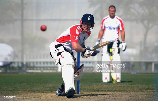 Eoin Morgan of England bats watched by captain Andrew Strauss during a nets session at the ICC Global Cricket Academy on February 1 2012 in Dubai...