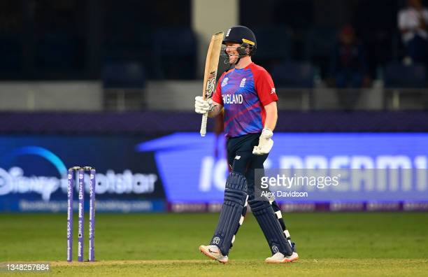 Eoin Morgan of England celebrates following the ICC Men's T20 World Cup match between England and Windies at Dubai International Stadium on October...