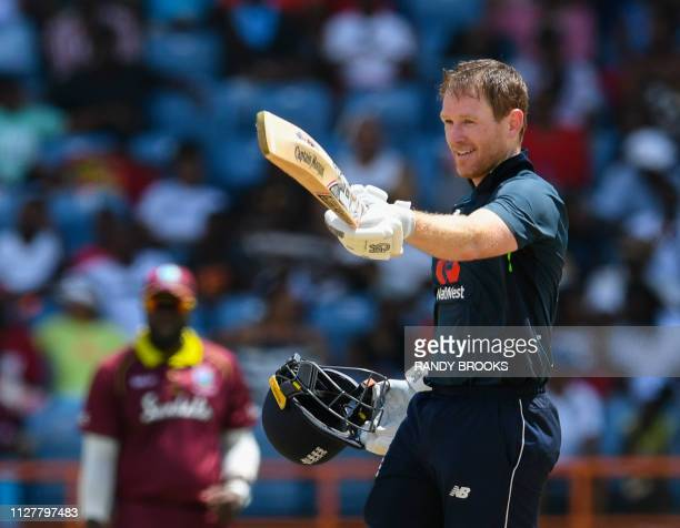 Eoin Morgan of England celebrates his century during the 4th ODI between West Indies and England at Grenada National Cricket Stadium Saint George's...