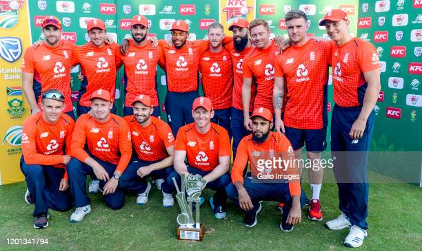 Eoin Morgan of England celebrates series victory with his teammates during the 3rd KFC T20 International match between South Africa and England at...