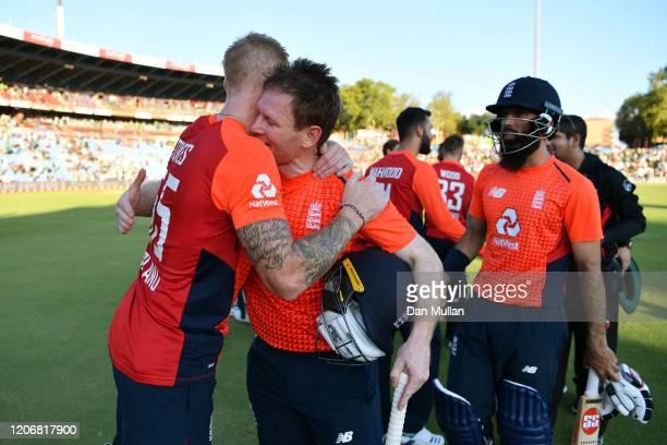 Eoin Morgan of England celebrates with Ben Stokes of England following their victory during the Third T20 International match between South Africa...