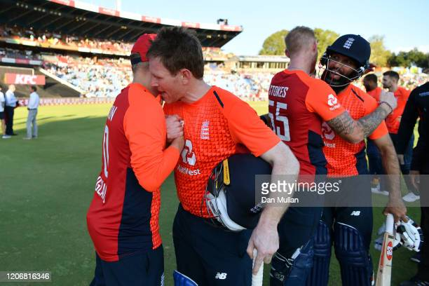 Eoin Morgan of England celebrates with Matthew Parkinson of England following their victory during the Third T20 International match between South...