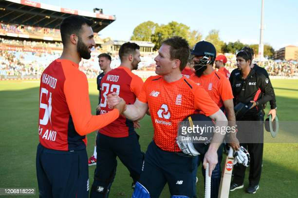 Eoin Morgan of England celebrates with Saqib Mahmood of England following their victory during the Third T20 International match between South Africa...