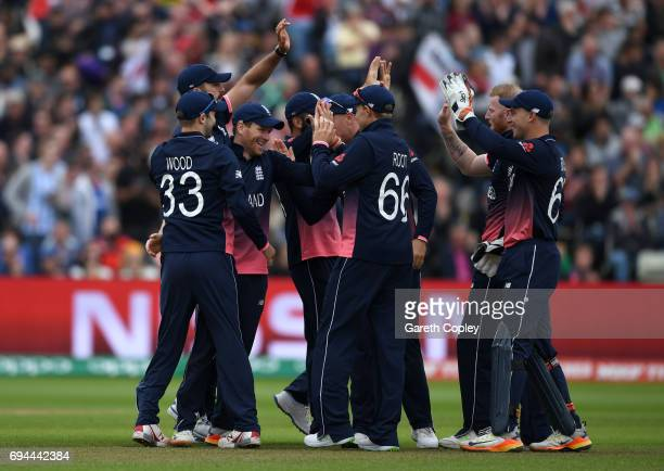 Eoin Morgan of England celebrates with teammates after catching out Aaron Finch of Australia during the ICC Champions Trophy match between England...