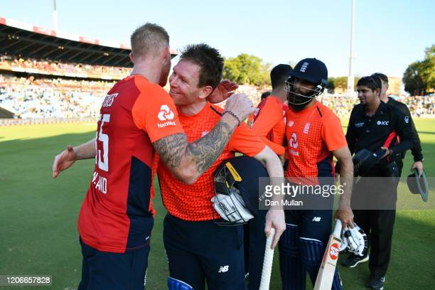 Eoin Morgan of England embraces Ben Stokes of England after victory during the Third T20 International match between South Africa and England at...