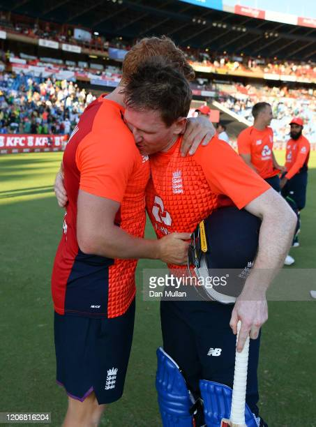 Eoin Morgan of England embraces Jonny Bairstow of England following their victory during the Third T20 International match between South Africa and...