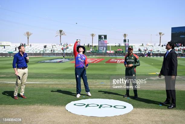 Eoin Morgan of England flips the coin as Mahmudullah of Bangladesh looks on ahead of the ICC Men's T20 World Cup match between England and Bangladesh...