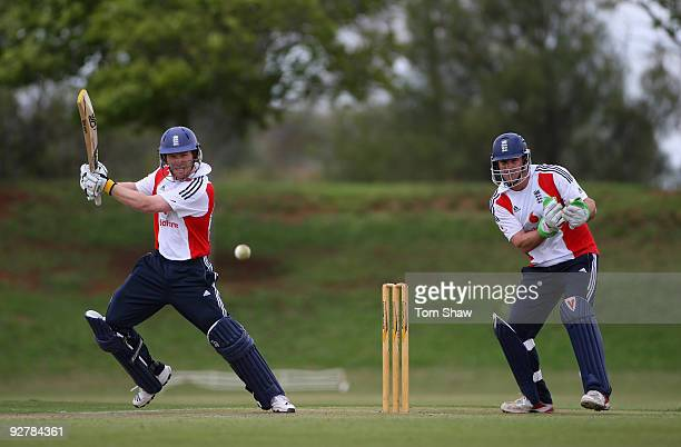 Eoin Morgan of England hits out as Andrew Strauss of England keeps wicket during the England nets session at The University of Free State on November...