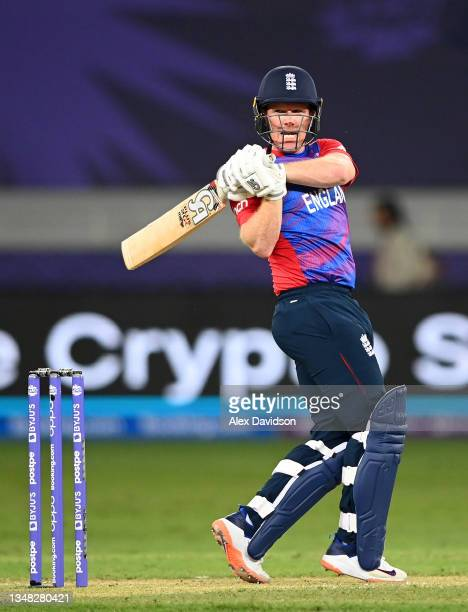 Eoin Morgan of England hits runs during the ICC Men's T20 World Cup match between England and West Indies at Dubai International Stadium on October...