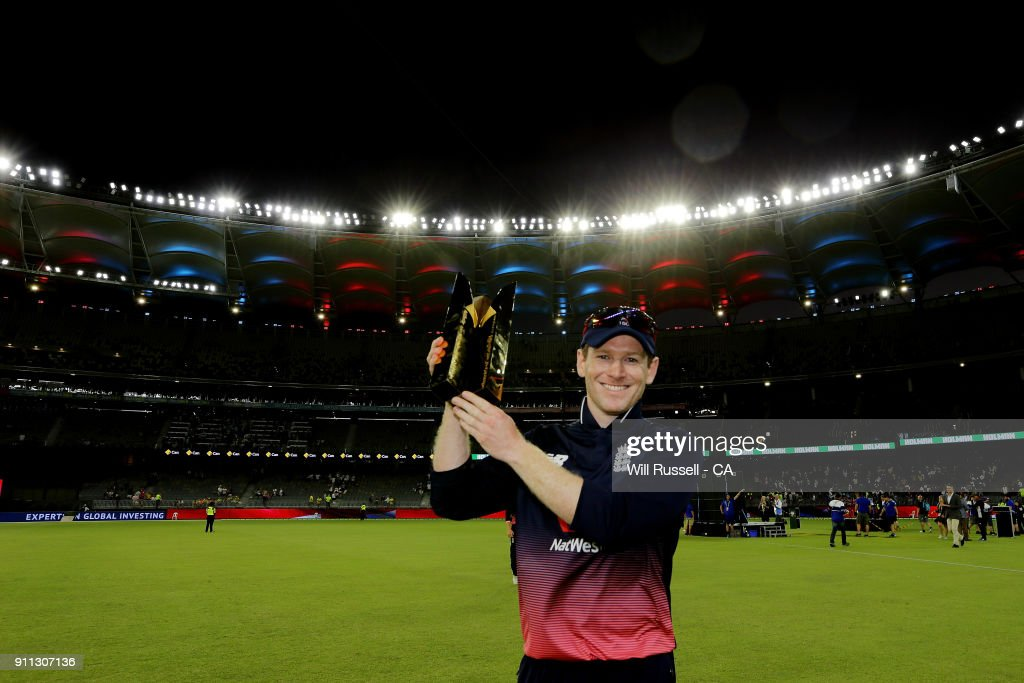 Eoin Morgan of England holds aloft the trophy after defeating Australia during game five of the One Day International match between Australia and England at Perth Stadium on January 28, 2018 in Perth, Australia.