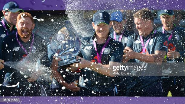 Eoin Morgan of England holds the series trophy after the fifth Royal London OneDay International match between England and Australia at Emirates Old...