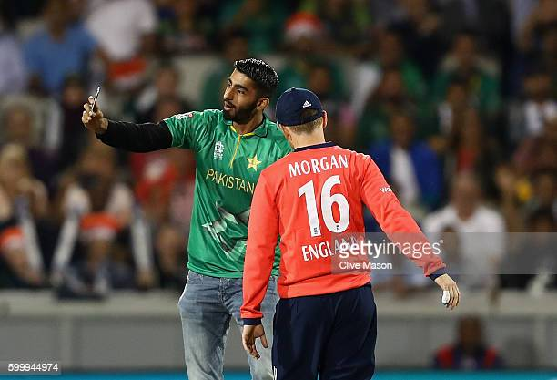 Eoin Morgan of England interacts with a pitch invader taking a selfie during the NatWest International T20 match between England and Pakistan at Old...