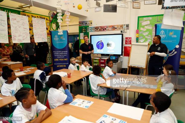 Eoin Morgan of England interacts with school kids during the launch of the 'Welcome to Our Area' and 'Playground Pundits' projects as part of the ICC...