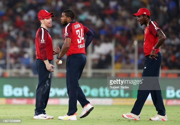 Eoin Morgan of England interacts with team mates Chris Jordan and Jofra Archer during the 2nd T20 International match between India and England at...