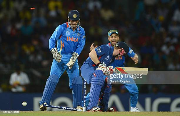 Eoin Morgan of England is bowled Harbhajan Singh of India during the ICC World Twenty20 2012 Group A match between England and India at R. Premadasa...