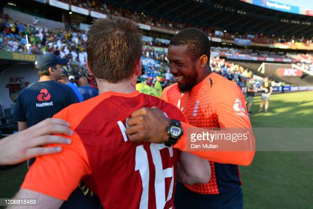 Eoin Morgan of England is congratulated by Jason Roy of England following their side's victory during the Third T20 International match between South...